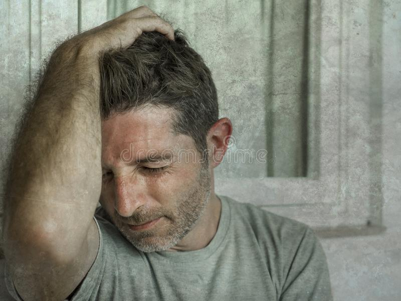 Dramatic portrait of sad and depressed 30s or 40s man in pain feeling stressed and broken suffering depression problem and anxiety royalty free stock photography