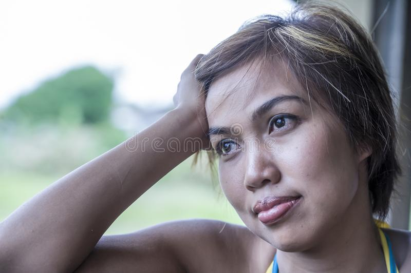 Dramatic portrait of sad and thoughtful young beautiful Asian woman on her 20s or 30s looking away outdoors pensive and sad stock photos