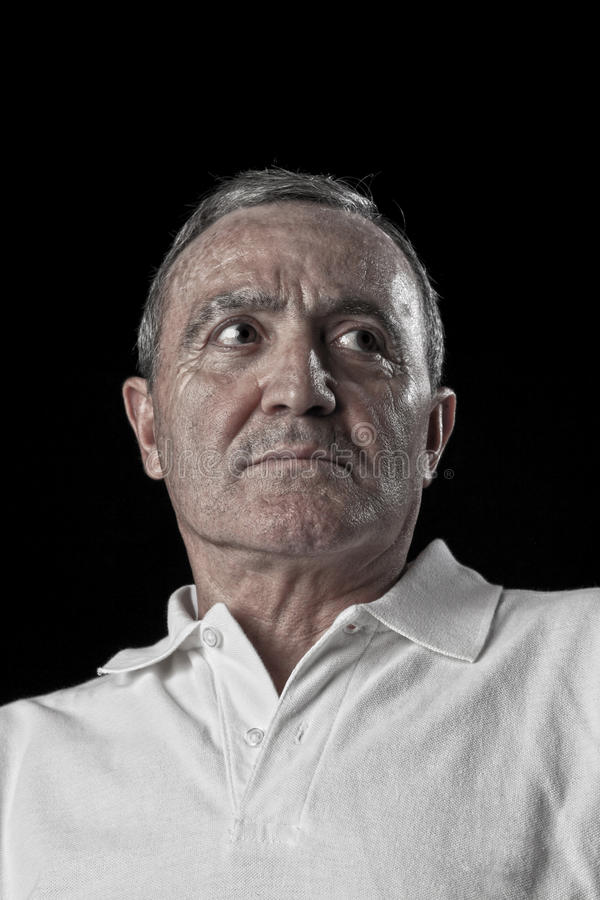 Dramatic portrait of a senior man stock image