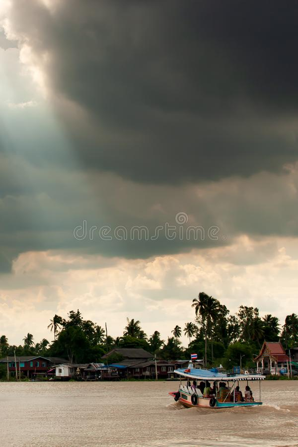 Dramatic rainstorm over ferryboat. On Chao Phraya River, the major river in Thailand stock images