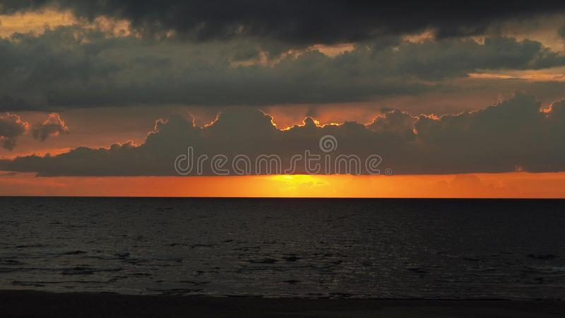 Dramatic red clouds at sunset sky stock image