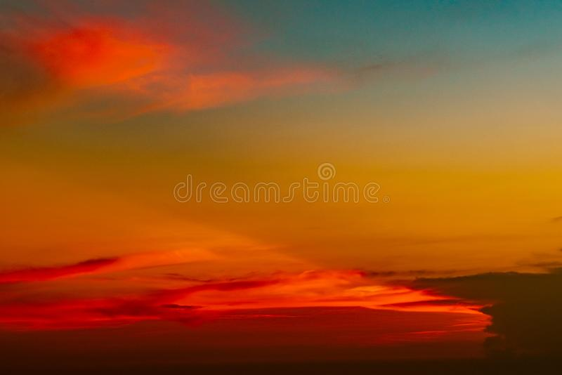 Dramatic red and orange sky and clouds abstract background. Red-orange clouds on sunset sky. Warm weather background. Art picture. Of sky at dusk. Sunset royalty free stock photos