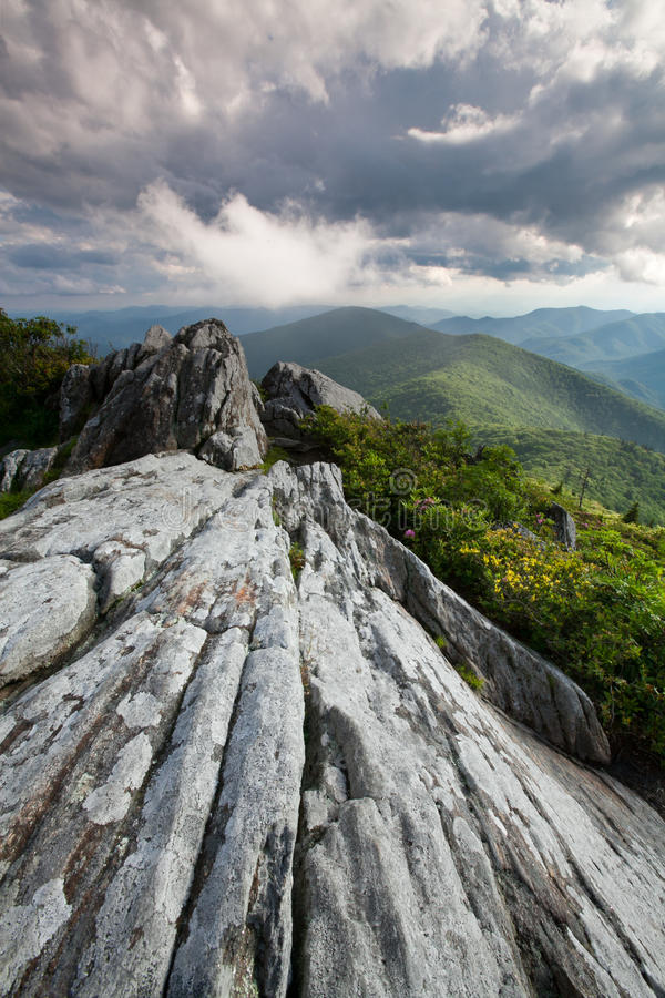Dramatic Rock Outcrop Blue Ridge Mountains. Aged stone rock leads the eye into the Swannanoa Valley in Western North Carolina. Here the Great Craggy Mountains royalty free stock photo