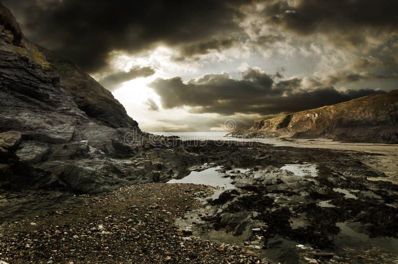 Dramatic rocky beach landscape stock photo