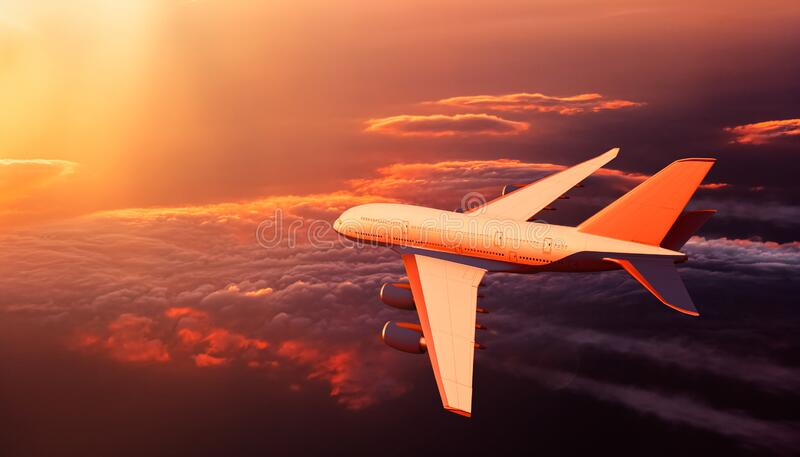 Dramatic scenery with airplane or airliner or aircraft in flight over clouds at sunset. Travel, transport industry or royalty free stock photography