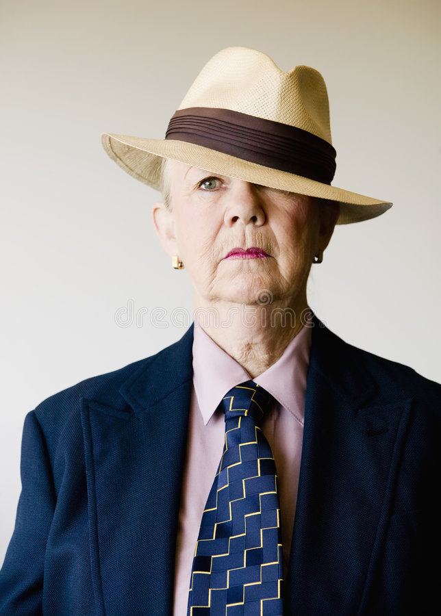 Dramatic Senior Woman Wearing A Hat Stock Image