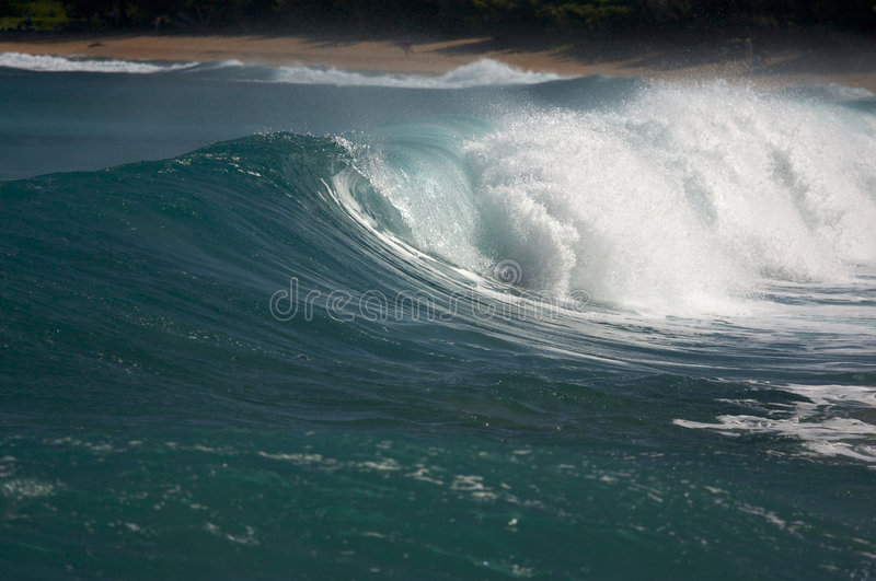 Dramatic Shorebreak Wave. On a clear morning royalty free stock image