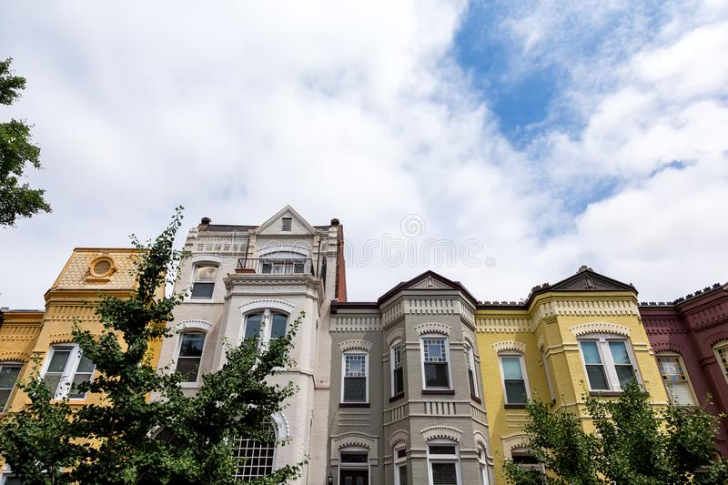 Dramatic shot of row houses in Washington DC on a summer afternoon. Row houses in the Washington DC neighborhood of Bloomingdale on a summer day stock photography