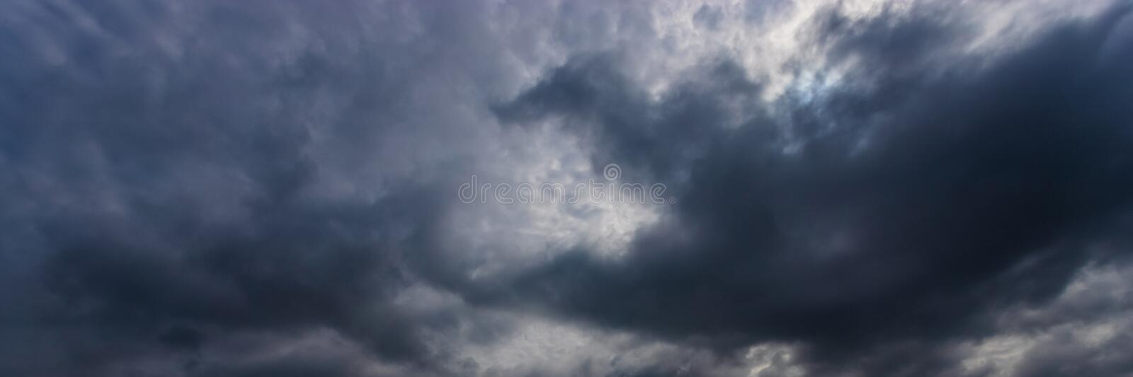 Dramatic Sky Background. Storm clouds in the dark sky. Gloomy Cloudy Landscape. You can use a panoramic image as a web banner or stock photo