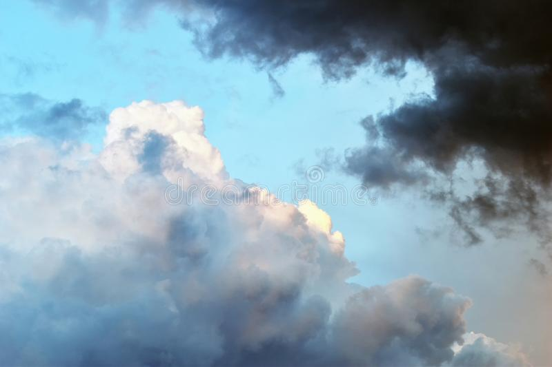 Dramatic sky with clouds and sun. Dramatic clouds and sunset light mix in a stormy sky stock photo