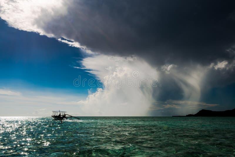 Dramatic sky with cumulonimbus clouds over turquoise South Pacific Ocean, Bora Bora stock photo