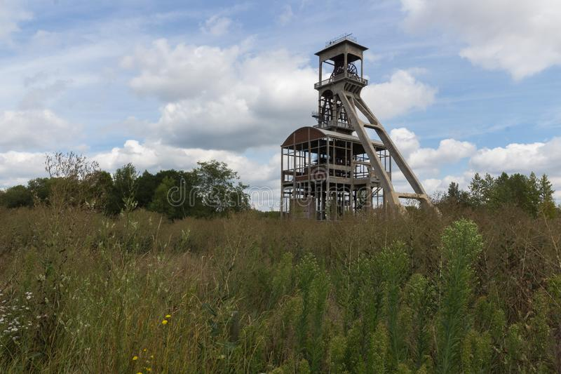 For coal mine elevators under a dramatic sky near Maasmechelen Village. A dramatic sky with former elevator shaft for the coal mines in Maasmechelen, Belgium royalty free stock image