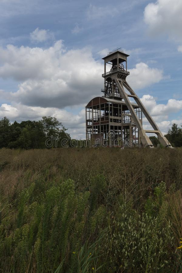 For coal mine elevators under a dramatic sky near Maasmechelen Village. A dramatic sky with former elevator shaft for the coal mines in Maasmechelen, Belgium stock photos