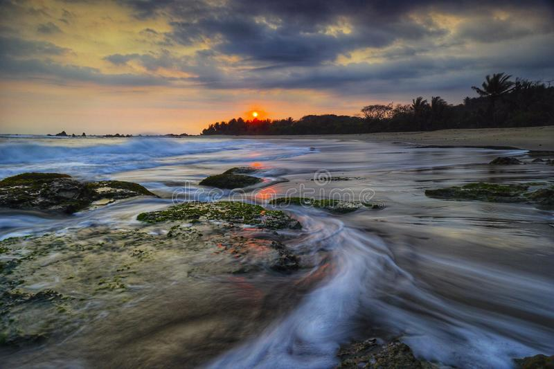 A dramatic sky in Karang Bobos beach, Banten, Indonesia royalty free stock photo