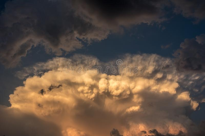 Dramatic sky with ominous storm clouds. In evening light royalty free stock photo