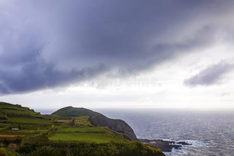 Dramatic sky over Atlantic Ocean coast near Sao Miguel Island, Azores, Portugal stock photos