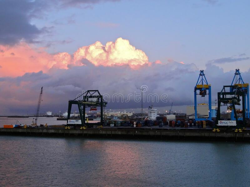 Dramatic sky over ferry and container port, Zeebrugge. Belgium royalty free stock photos