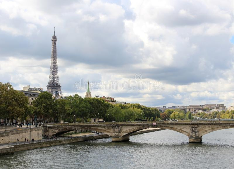 Dramatic sky over the Seine in Paris, France. View of the Eiffel Tower and Jena Bridge royalty free stock photo