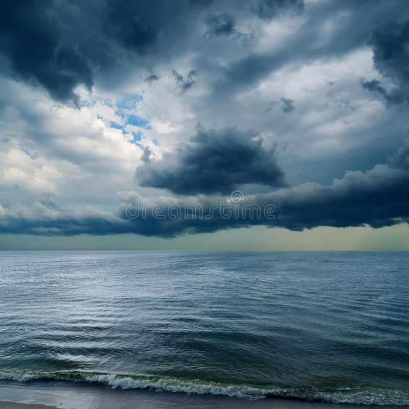 Dramatic sky over water stock photos