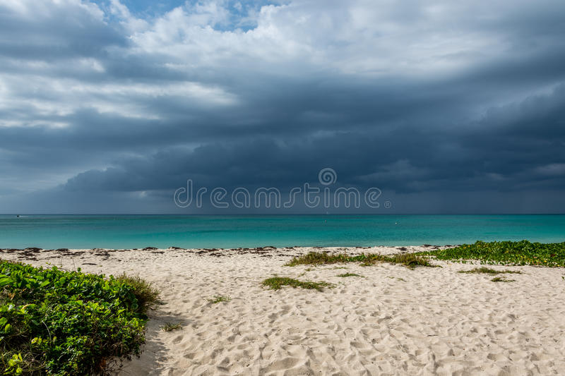 Dramatic sky at Seven mile beach royalty free stock images