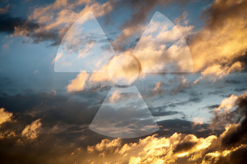Dramatic sky with symbol of radioactivity stock images