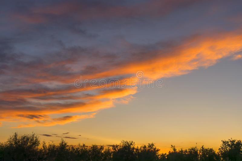.. Dramatic sky. Very beautiful sunset. Yellow orange sky. Beautiful evening landscape stock photo