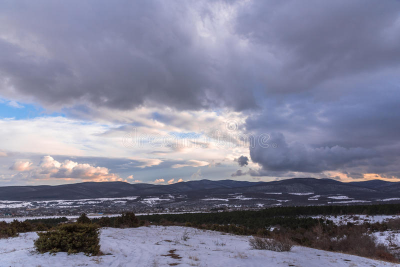 Dramatic sky winter landscape. Mountain view. Dark dramatic stormy grey clouds royalty free stock image