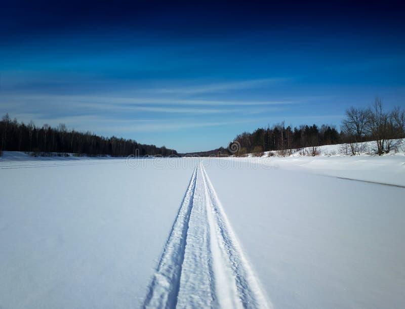 Dramatic snowmobile winter road landscape background stock photo