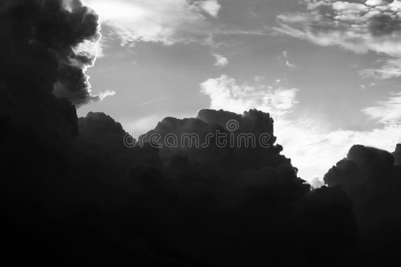 The dramatic storm Cloud and the evening sky in Black and White. Monochrome Cloudscape stock images