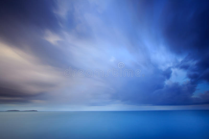 Dramatic storm cloud and sky at dusk. Long exposure technique royalty free stock images