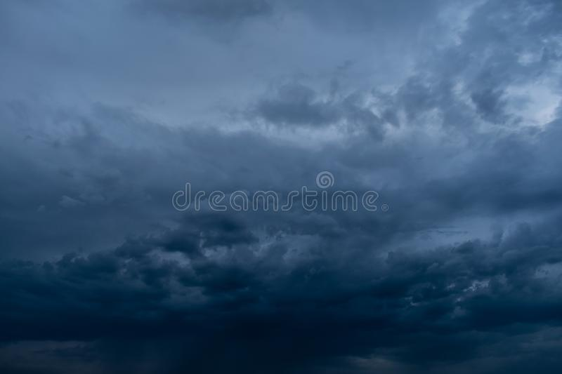 Dramatic stormy dark cloudy sky, natural photo background. Airs, atmospheres, backgrounds, beautiful, blues, cloudiest, clouds, cloudscapes, colors, dangers stock photography