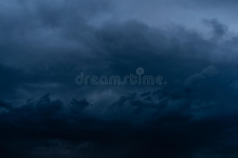 Dramatic stormy dark cloudy sky, natural photo background. Airs, atmospheres, backgrounds, beautiful, blues, cloudiest, clouds, cloudscapes, colors, dangers royalty free stock photo
