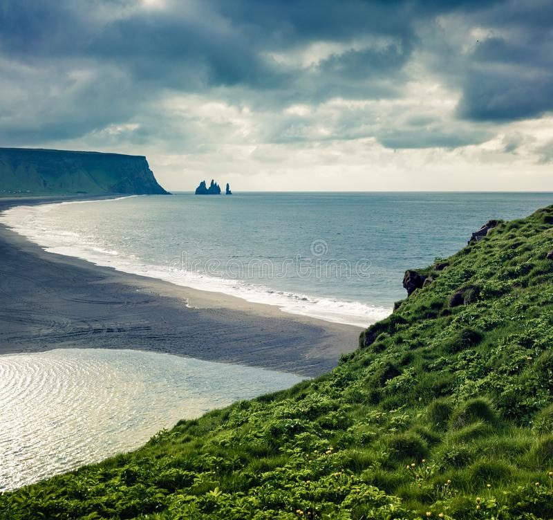 Dramatic summer morning in Dyrholaey Nature Reserve with view of black sund Reynisfjara beach. Great outdoor view of Reynisdranga. R cliffs in the Atlantic ocean stock image
