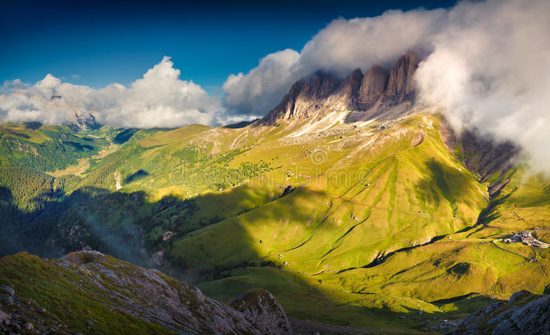 Dramatic summer morning on the Sassolungo (Langkofel) group. View from the Sella pass. National Park Dolomites, South Tyrol. Location Ortisei, S. Cristina and royalty free stock photo