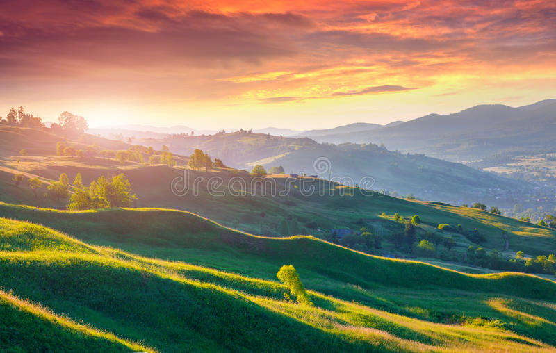 Dramatic summer sunrise in mountains royalty free stock images