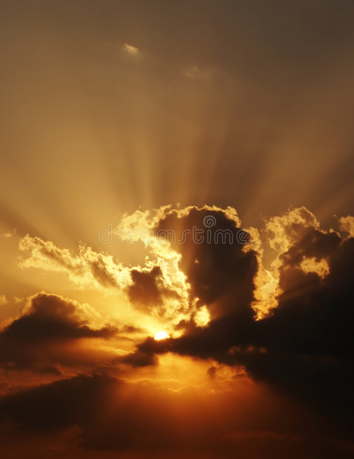 Download Dramatic Sundown Scene With Dark Clouds And Rays Stock Photo - Image: 4870696