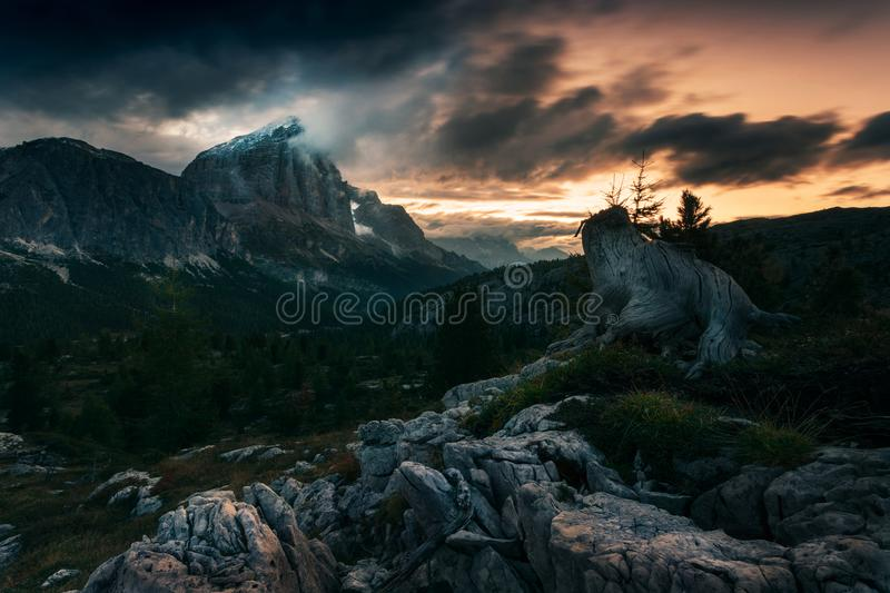 Dramatic sunrise in Dolomite with heavy clouds and light. During morning light royalty free stock photos