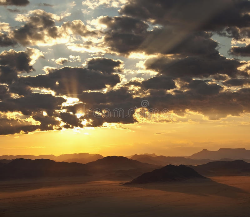 Dramatic sunrise - Namibia. Aerial view of a dramatic sunrise over the Namib-Naukluft Desert near Sossusvlei in Namibia royalty free stock images