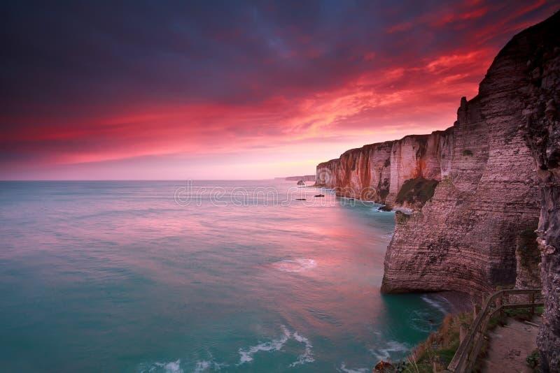 Dramatic sunrise over ocean and cliffs. Etretat, France stock photo