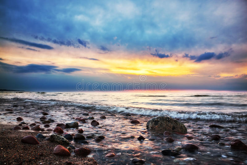 Download Dramatic Sunrise On A Rocky Beach. Baltic Sea Stock Photo - Image: 33453548