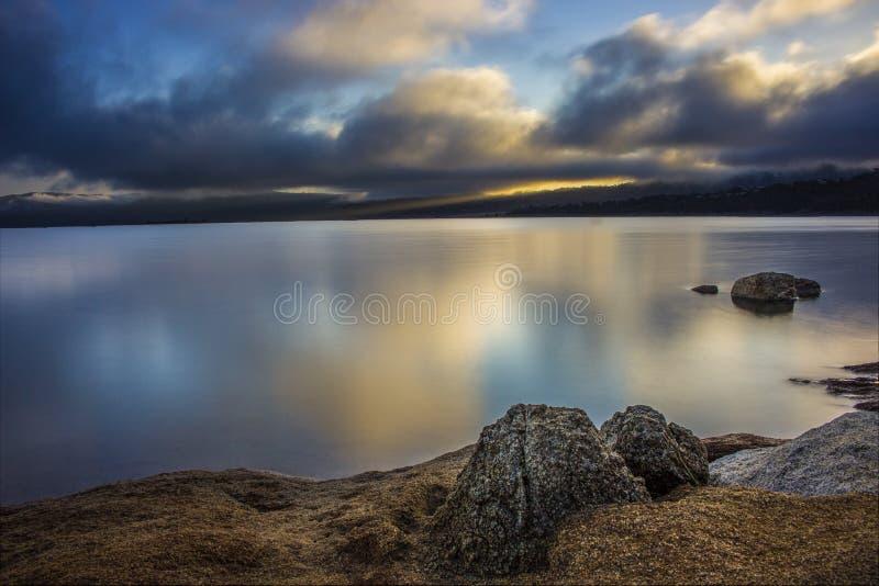Dramatic sunrise. Dramatic sky during sunrise over the Lake Jindabyne royalty free stock images