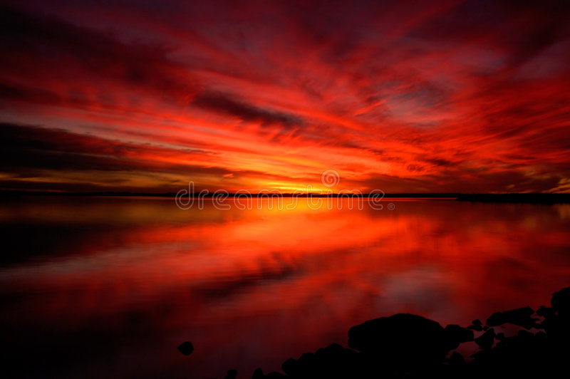 Download Dramatic sunset stock photo. Image of water, reflection - 129290