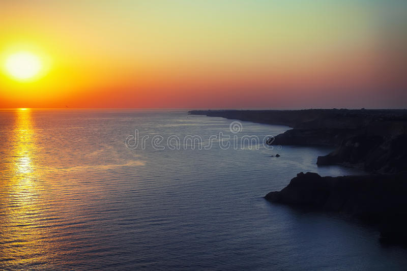 Dramatic sunset at cape Fiolent. With rocks and grass at foreground. Crimea royalty free stock photo