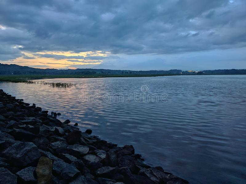 Dramatic sunset cloudy at bade reservoir Boyolali Indonesia. Beautiful scenery royalty free stock photo