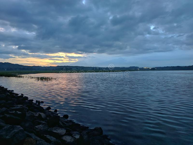 Dramatic sunset cloudy at bade reservoir Boyolali Indonesia. Beautiful scenery royalty free stock images