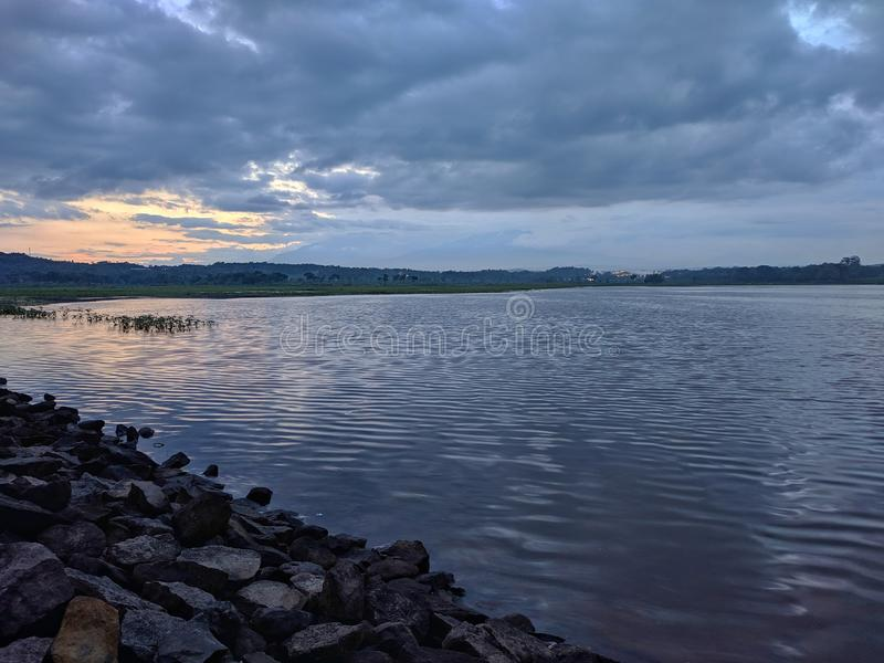 Dramatic sunset cloudy at bade reservoir Boyolali Indonesia. Beautiful scenery royalty free stock photo
