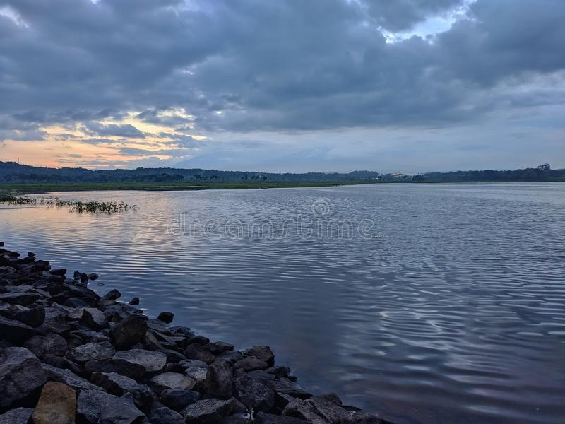 Dramatic sunset cloudy at bade reservoir Boyolali Indonesia. Beautiful scenery royalty free stock photos