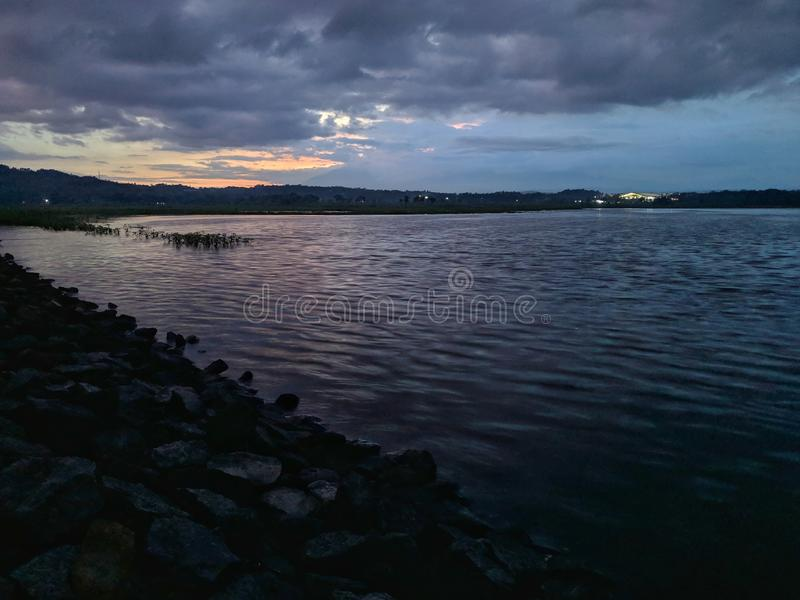 Dramatic sunset cloudy at bade reservoir Boyolali Indonesia. Beautiful scenery royalty free stock image