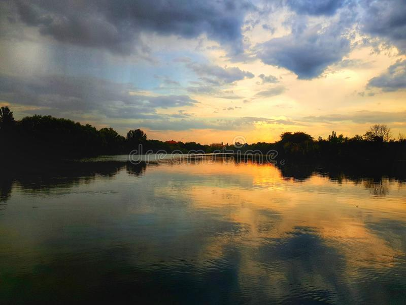 Dramatic sunset at lake stock photos