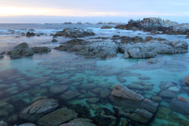 Dramatic Sunset on Monterey coast, Asilomar State Park, near Carmel, California, USA royalty free stock photo